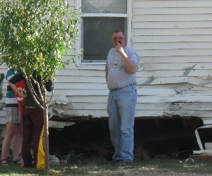 man contemplating the damage after the car was removed